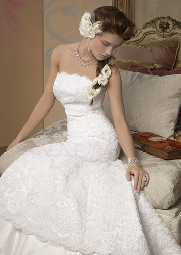 My advice is to go for the classic lace wedding gown